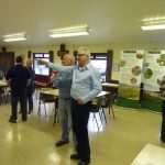 Photograph of MC talking to people at Parish Plan 2 event at Quarrington Hill