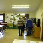 Photograph of people in conversation at parish planning event in 2011