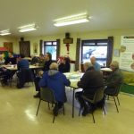 Photograph of people taking part in parish planning and creating ideas