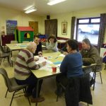 Photograph of people talking about in parish planning