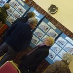 Photograph of people looking at exhibition