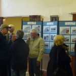 Photograph of people talking aboutexhibition
