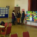 Photograph of people being involved in at exhibition