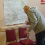 Photograph of parish planning participants at work looking at maps