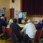 Photograph of parish planning participants at work with speaker