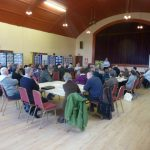 Photograph of a full hall of parish planning participants at work