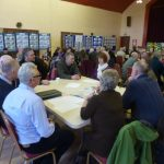 Photograph of enthusiastic parish planning participants at work