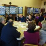Photograph of parish planning participants comparing notes