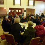 Photofraph of parish planning participants at work sharing views