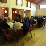 Photograph of parish planning participants at work raising points of view