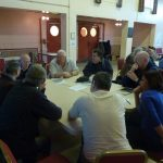 Photograph of parish planning participants at work listening carefully