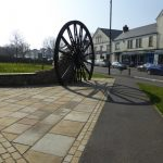 Photograph of pit wheel and shadow taken looking south up front street