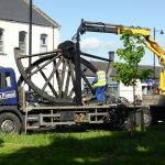 Photograph of pitwheel being taken off lorry by crane BACK IN 2014