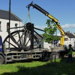 Photograph of pitwheel being taken off lorry by crane Step 2