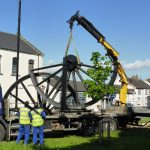 Photograph of pitwheel being taken off lorry by crane step 3