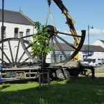 Photograph of pitwheel being taken off lorry by crane step 4