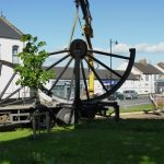 Photograph of pitwheel being taken off lorry by crane step 5