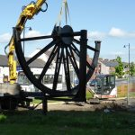 Photograph of pitwheel being taken off lorry by crane Step 7