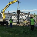 Photograph of pitwheel being lowered to site step 10