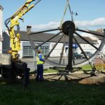 Photograph of pitwheel being lowered to site step 11