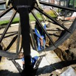 Photograph of pitwheel being fixed to site nearly there