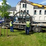 Photograph of second half of pitwheel being fixed to site