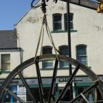 Photograph of second half of pitwheel beinglifted from the transporter