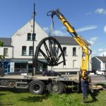 Photograph of second half of pitwheel being fixed to site step 6