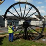 Photograph of second half of pitwheel being fixed to site step 9