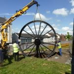 Photograph of second half of pitwheel being fixed to site step 10