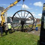 Photograph of second half of pitwheel being fixed to site step 11