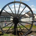 Photograph of second half of pitwheel being fixed to site step 12