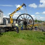 Photograph of second half of pitwheel being fixed to site step 13