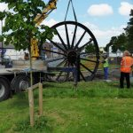 Photograph of second half of pitwheel being fixed to site step 14