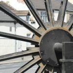 Photograph of second half of pitwheel being fixed to site nearly complete