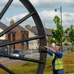 Photograph of second half of pitwheel being fixed to site and set in place