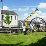 Photograph of second half of pitwheel being fixed to site taken in panorama