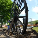 Photograph of second half of pitwheel being fixed to site taken from side