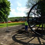 Photograph of second half of pitwheel being fixed to site with shadow