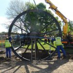 Photograph of second half of pitwheel being fixed to site with full shadow