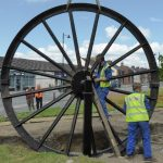 Photograph of secong half of pitwheel being fixed to site