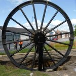 Photograph of second half of pitwheel being fixed to site without workers