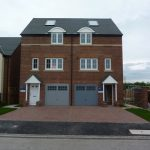 Photograph of more three storey houses complete