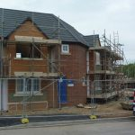 Photograph of house being built and finished off