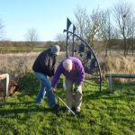 Photograph of former members of Coxhoe Community Partnership planting bulbs