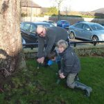 Photograph of young volunteers planting bulb