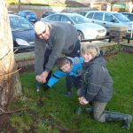 Photograph of Parish chair and sons digging