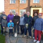 Photograph of former members of Coxhoe Community Partnership happy with their achievements