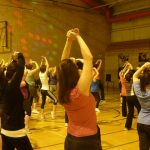 Photograph of Zumba participants raisng arms