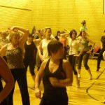 Photograph of Zumba participants getting into it